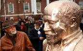 Artist Ayokunle Odeleye with his W.E.B Dubois Bust